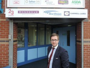Photo of Bootle Solicitor Kevin Donoghue at the entrance to Brunswick Youth Club.