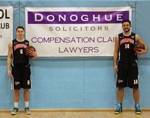 Photo of basketball players in front of the Donoghue Solicitors sign at Liverpool Basketball Club.