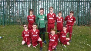 Photo of Orrets Meadow football team wearing kits donated by Donoghue Solicitors.