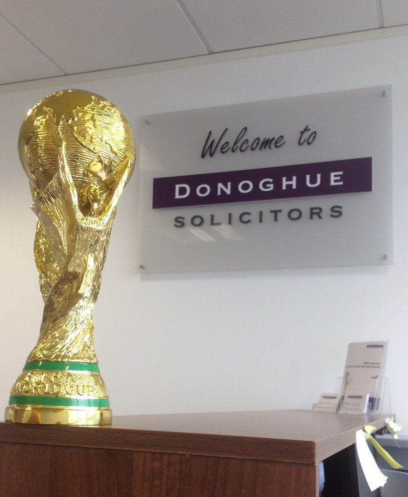 "Picture of the 5-a-side ""World Cup"" winners' trophy at Donoghue Solicitors' offices."